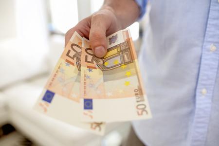 Man hand fifty banknotes euro indoor