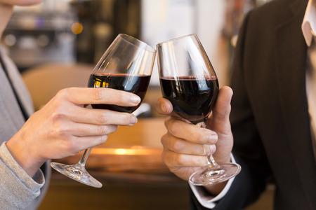 male female cheers alcohol bar