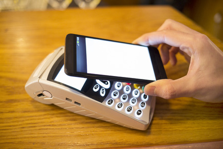 checkout: Male hand smartphone wallet payment shop