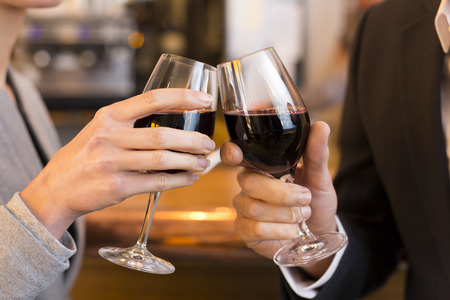 toasting wine: male female cheers alcohol bar