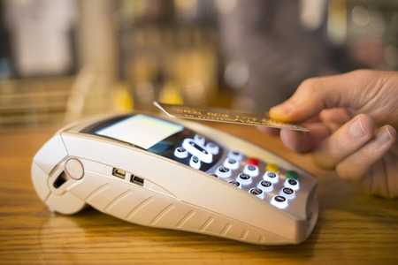 pay bill: Male hand wallet payment shop