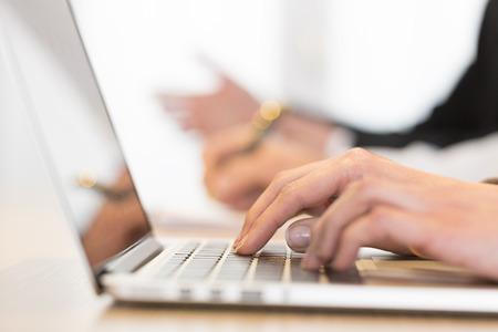 Female computer keyboard desk colleague background Imagens