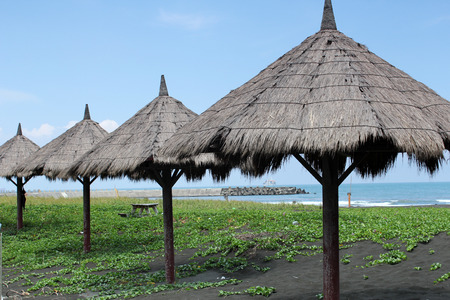Hsitzuwan thatched umbrella tent at the beach side