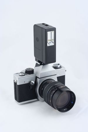 Vintage 35mm film camera with electronic flash on it