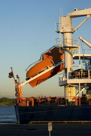 Lifeboat on a freight cargo ready to go