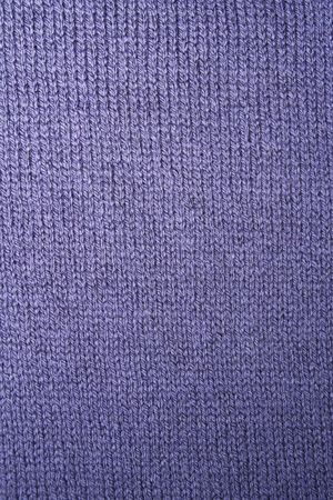 acrylic yarn: Background made of a piece of knitted blue wool
