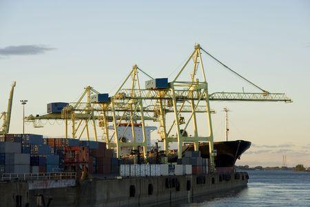 intermodal: Container cranes loading a ship in a major port Stock Photo