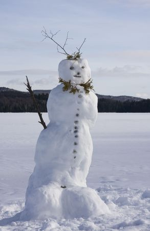 Winter landscape with a snowman in front Stock Photo - 2319311