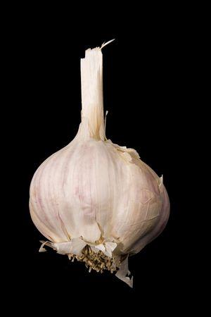 Photo of a clove of garlic over black background Reklamní fotografie