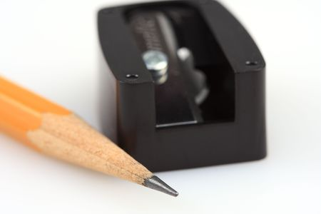Close up of a wooden pencil and its sharpener