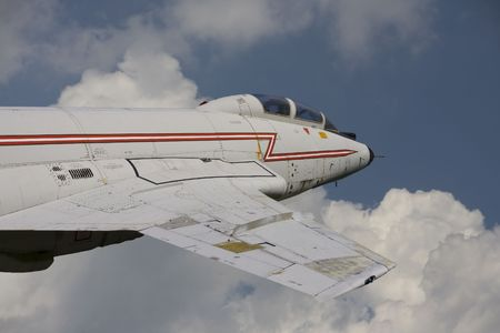 Close up photo of a vintage jet fighter in the sky