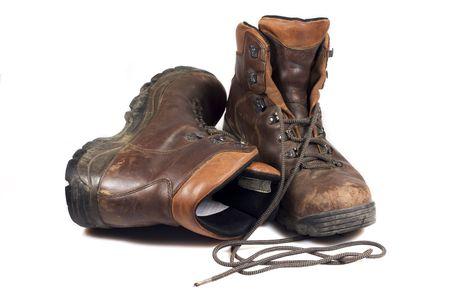Close-up van mijn oude wandelschoenen op witte achtergrond Stockfoto