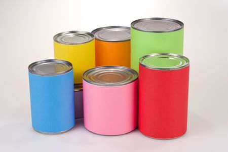 tin: Close up shot of various tin cans with plain colored labels Stock Photo