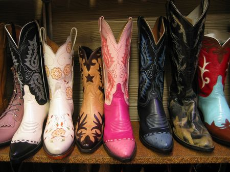 cowgirl boots: Colorful cowboy boots for sale on shelf. Stock Photo