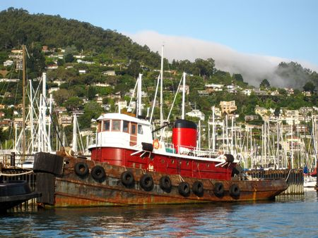 tugboat: Rusty old red tugboat docked in Sausalito harbor. Stock Photo