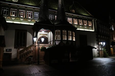historical German house with lights on a gloomy evening