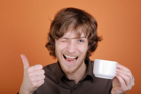 The emotional man with a cup in a hand and with copy space Stock Photo - 4370430