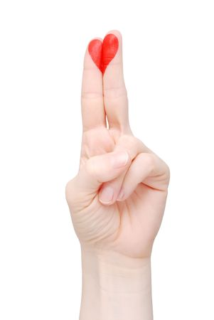 Red heart drawn on fingers on a white background (isolated) 版權商用圖片