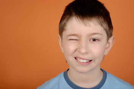 Boy with the big teeth winks Stock Photo
