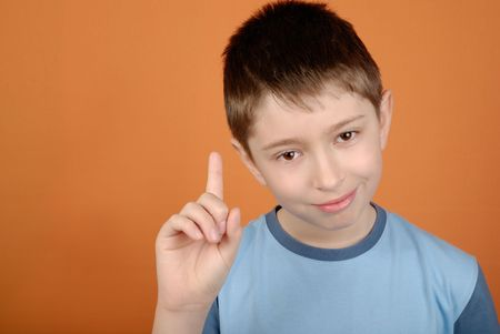 gesticulating: Reproaching, gesticulating boy with copy space Stock Photo