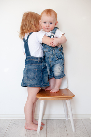 Red-haired girl and red-headed boy with atopic dermatitis Stock Photo