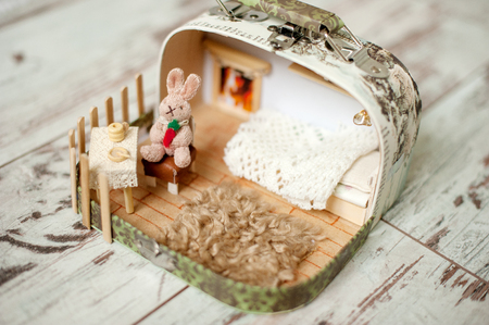 Dollhouse with a rabbit on a chair Stock Photo
