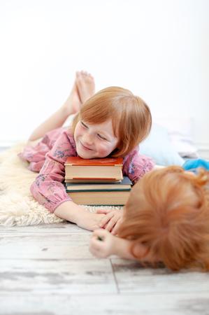 The girl hugs her favorite books