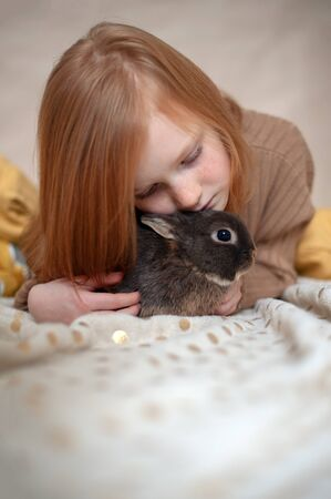 Red-haired girl with a rabbit