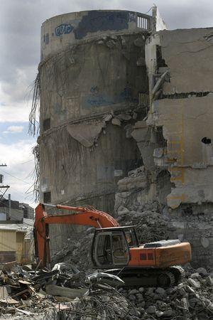 tearing down: A backhoe is tearing down a concrete parkade in Saskatoon, Saskatchewan