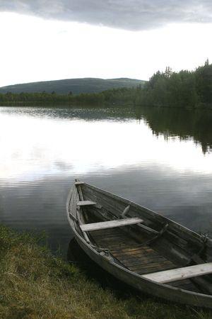 100 year old fishing boat on a northern lake nearroros r�ros, tolga; photo