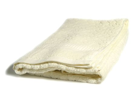laundered: A white folded towel isolated on a white background with a slight shadow
