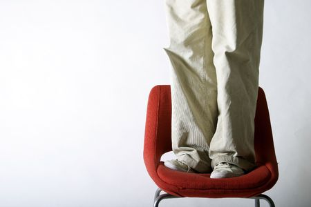 A pair of feet on a red chair Stock Photo - 261056