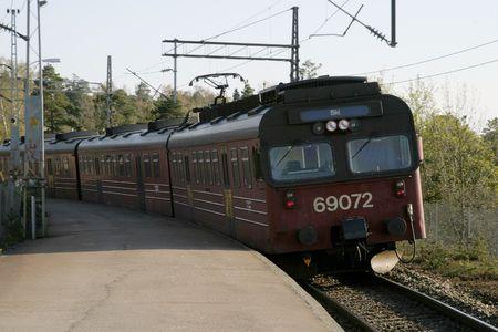 tog: Train coming to Ljan stasion in Oslo, Norway