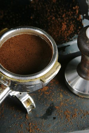 alluminum: Bayonet filled with espresso, leveled and tamped, ready to be put into the machine