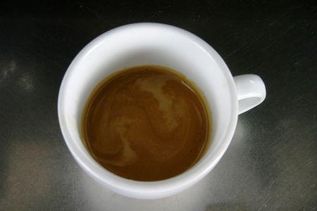 crema: Double espresso in a white cup with nice crema Stock Photo