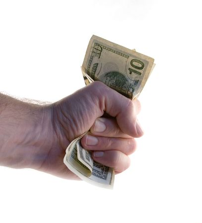wad: A male hand holding a tight wad of american money.