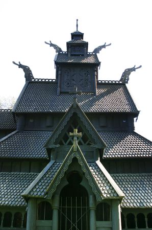 Stavkirke (stave church) located at the folk museum in Oslo, Norway.  The Norwegian Stave Churches are some of the oldest wooden structures in the world. photo