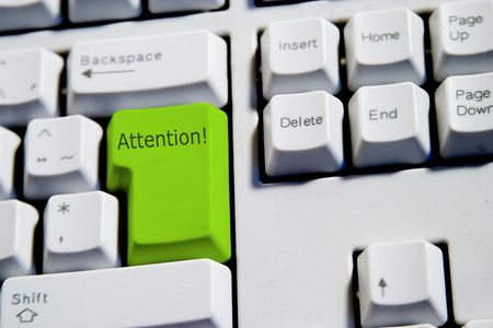 Computer Keyboard from a desktop computer with the enter key highlighted in green with the word attention Stock Photo - 263793