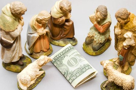 Commercialism vs Christmas, full nativity scene including money photo