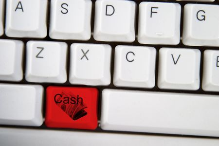 Isolated alt key displaying the word cash and a roll of american $20 bills, on a computer desktop keyboard highlighted in red. Stock Photo - 265209