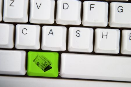 action fund: Keyboard keys displaying the word cash, with the alt button replaced with a $20 american bill roll