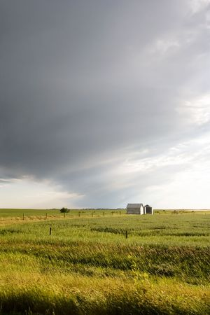 flatland: Prairie Landscape with grain bins Stock Photo
