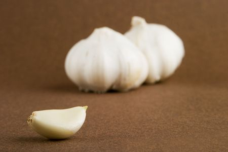 Garlic (Allium sativum) cloves on a dark background photo