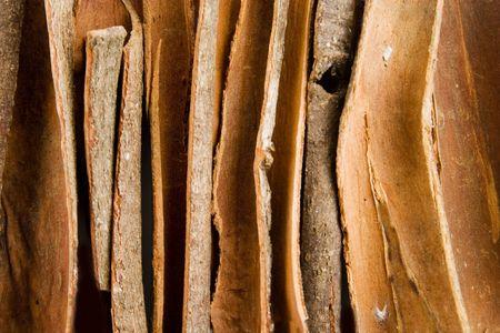 Bulk cinnamon sticks background texture photo