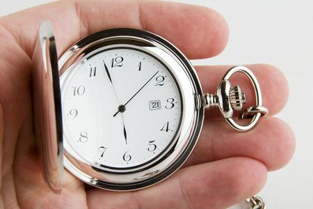 constraint: A male hand holding a fancy pocket watch