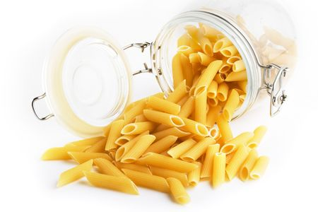 dehydrate: Penne Rigate pasta in a glass jar Stock Photo