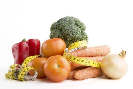 Grupo de los alimentos vegetales con cinta métrica  Foto de archivo - 278313