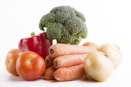 Group of raw vegetables on a white background photo