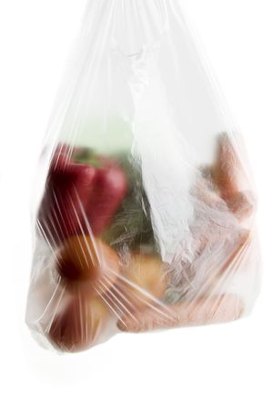 A clear plastic grocery bag filled with vegetables, a healthy choice photo