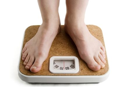 A pair of female feet standing on a bathroom scale Stock Photo - 280492